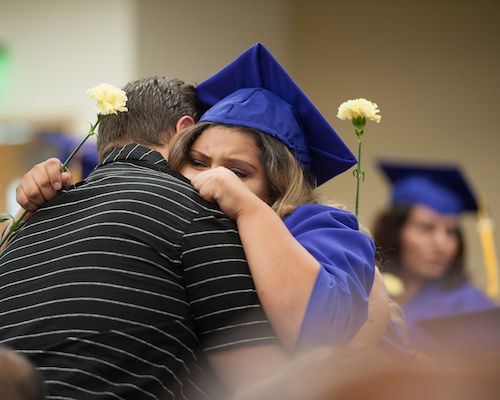 Joyous Gateway College Graduates Embrace