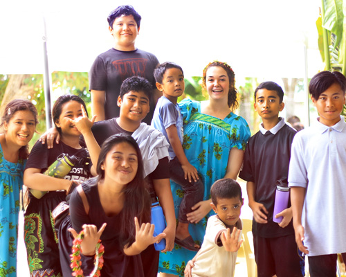 Madeline Cadavero, student missionary (through the North American Division Office of Volunteer Ministries) poses with some of her students in Chuuk, Micronesia.