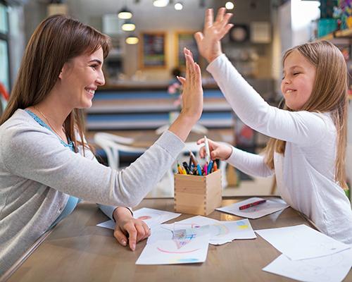 Blackmer commentary female teacher and girl high five
