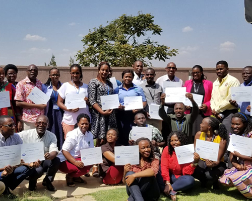 """Participants of the three-day training on """"Assisting Individuals in Crisis"""" display their certificates of completion."""
