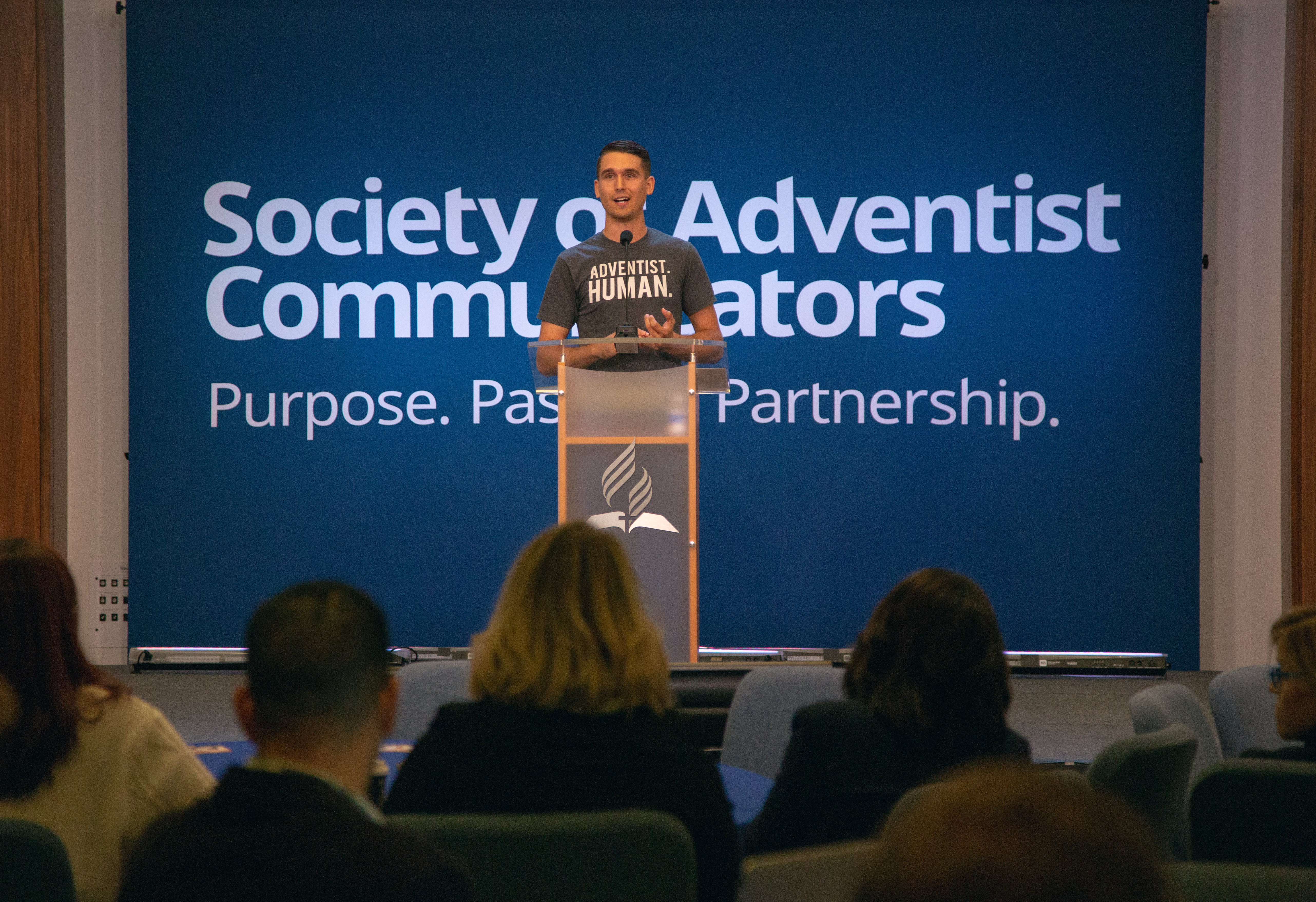 """Kaleb Eisele, creator of """"Humans of Adventism,"""" the social media storytelling ministry, tells attendees, """"Everything we do, you can do on your cell phone."""""""