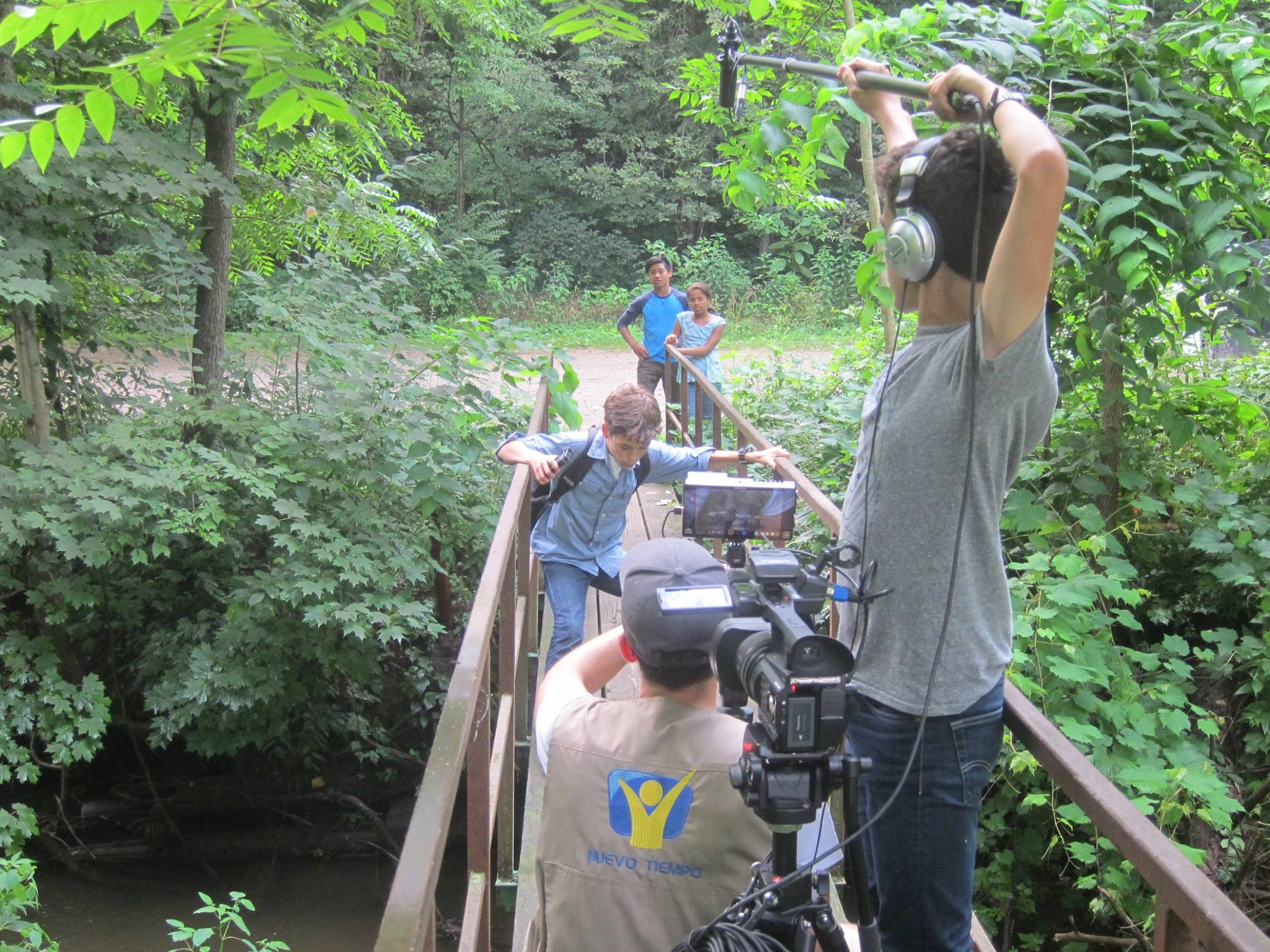 Film crew of The Mysterious Note captures a scene involving three of the film's actors.