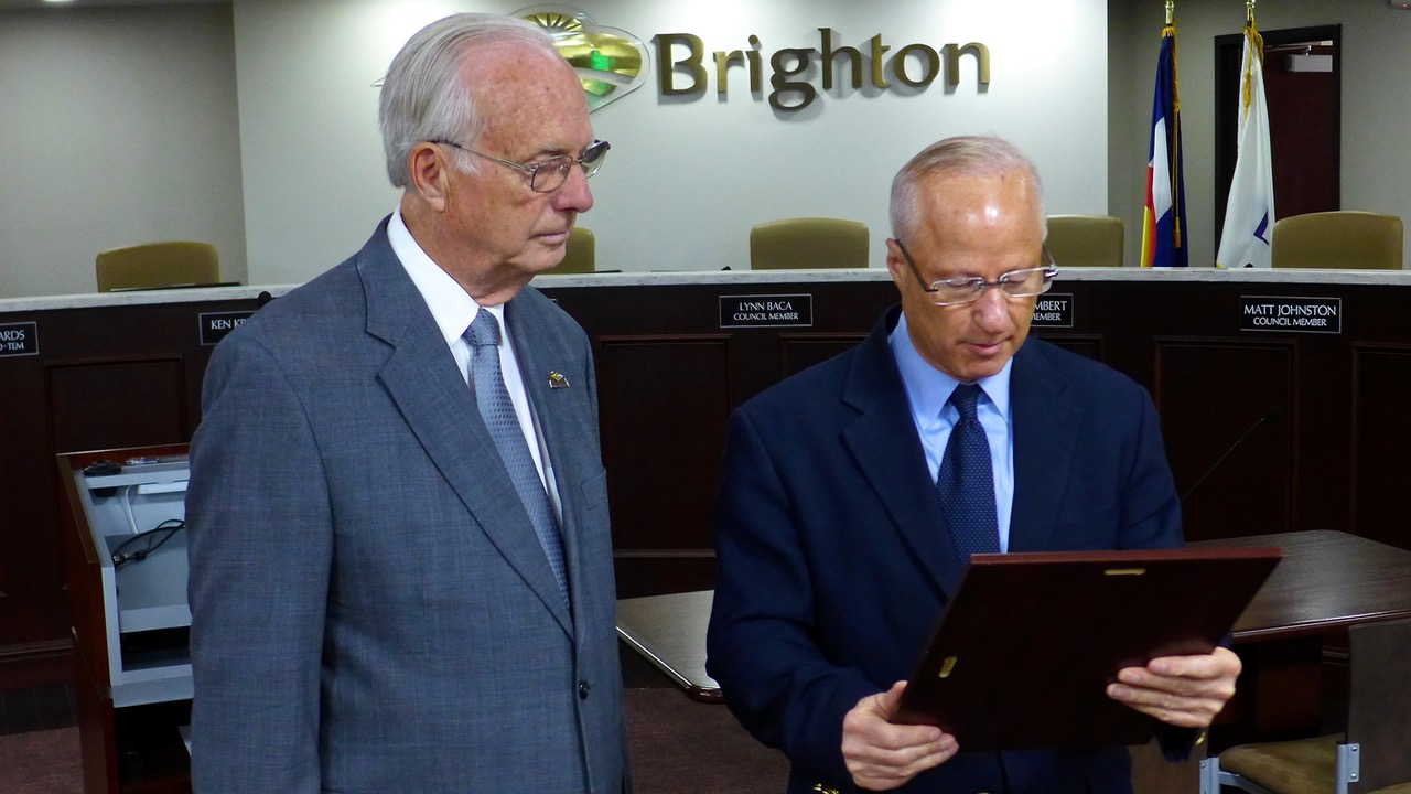 U.S. Representative Mike Coffman (right) presenting Pastor Rex Bell with Congressional Citation, Brighton, May 1, 2018